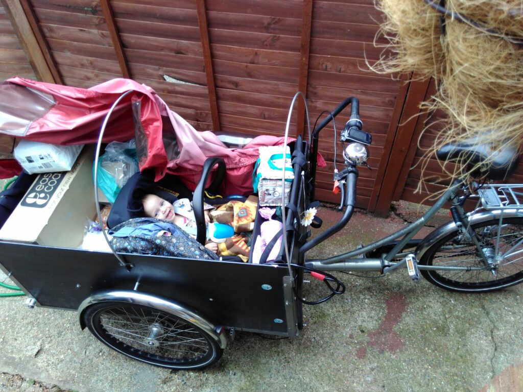 Cargo trike with shopping and baby on board.